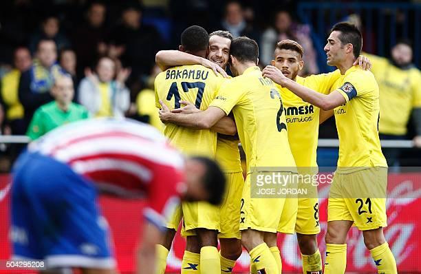 Villarreal's Congolese forward Cedric Bakambu celebrates with ValenciaVillarreal's forward Roberto Soldado Villarreal's Mexican forward Jonathan dos...