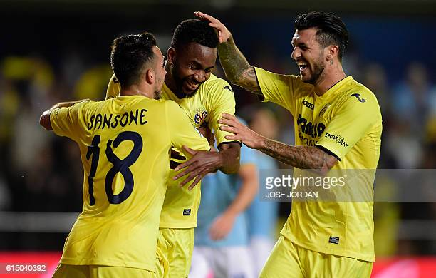 Villarreal's Congolese forward Cedric Bakambu celebrates with Villarreal's Italian forward Nicola Sansone and Villarreal's Italian midfielder Roberto...