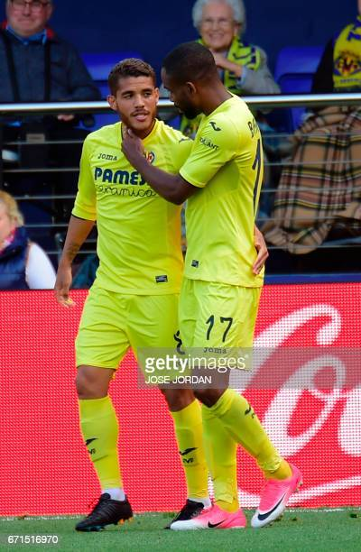 CORRECTION Villarreal's Congolese forward Cedric Bakambu celebrates with Villarreal's Mexican midfielder Jonathan dos Santos after scoring during the...