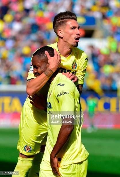 Villarreal's Congolese forward Cedric Bakambu celebrates with Villarreal's midfielder Samuel Castillejo after scoring during the Spanish league...