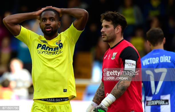 Villarreal's Congolese forward Cedric Bakambu reacts after missing an attempt on goal during the Spanish league football match Villarreal CF vs Club...