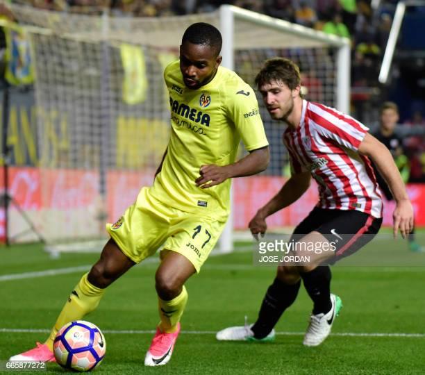 Villarreal's Congolese forward Cedric Bakambu vies with Athletic's defender Yeray Alvarez during the Spanish league football match Villarreal CF vs...