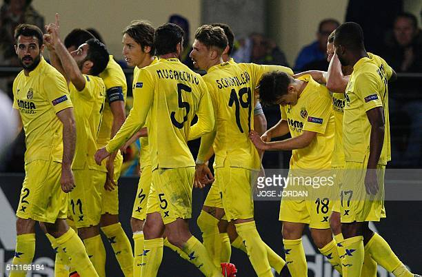 Villarreal's defender Denis Suarez celebrates a goal with teammates during the UEFA Europa League Round of 32 first leg football match Villarreal CF...