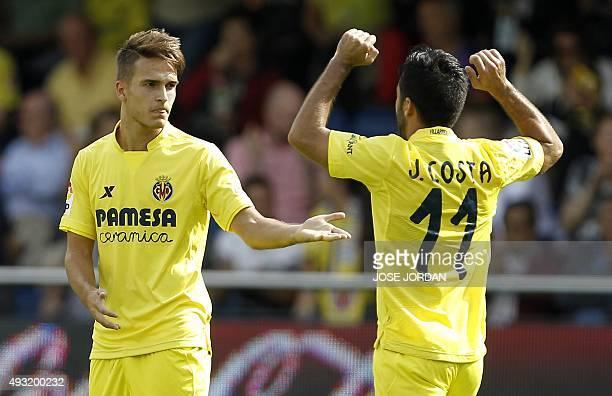 Villarreal's defender Denis Suarez celebrates his goal with a teammate during the Spanish league football match Villarreal CF vs RC Celta de Vigo at...