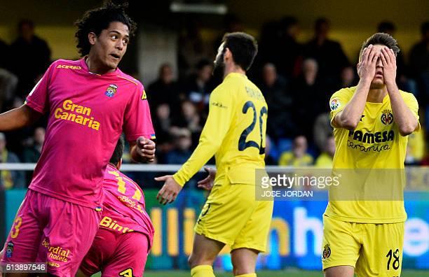 Villarreal's defender Denis Suarez gestures next to Las Palmas' Uruguayan defender Mauricio Lemos during the Spanish league football match Villarreal...