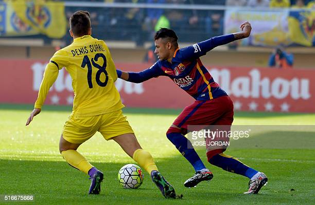 Villarreal's defender Denis Suarez vies with Barcelona's Brazilian forward Neymar during the Spanish league football match Villarreal CF vs FC...