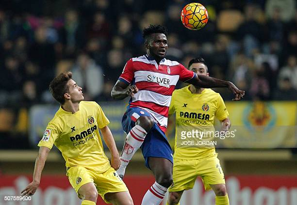 Villarreal's defender Denis Suarez vies with Granada's Nigerian forward Success Isaac during the Spanish league football match Villarreal CF vs...