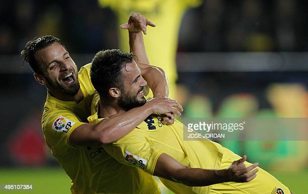 Villarreal's defender Mario celebrates his goal with Villarreal's forward Roberto Soldado during the Spanish league football match Villarreal CF vs...