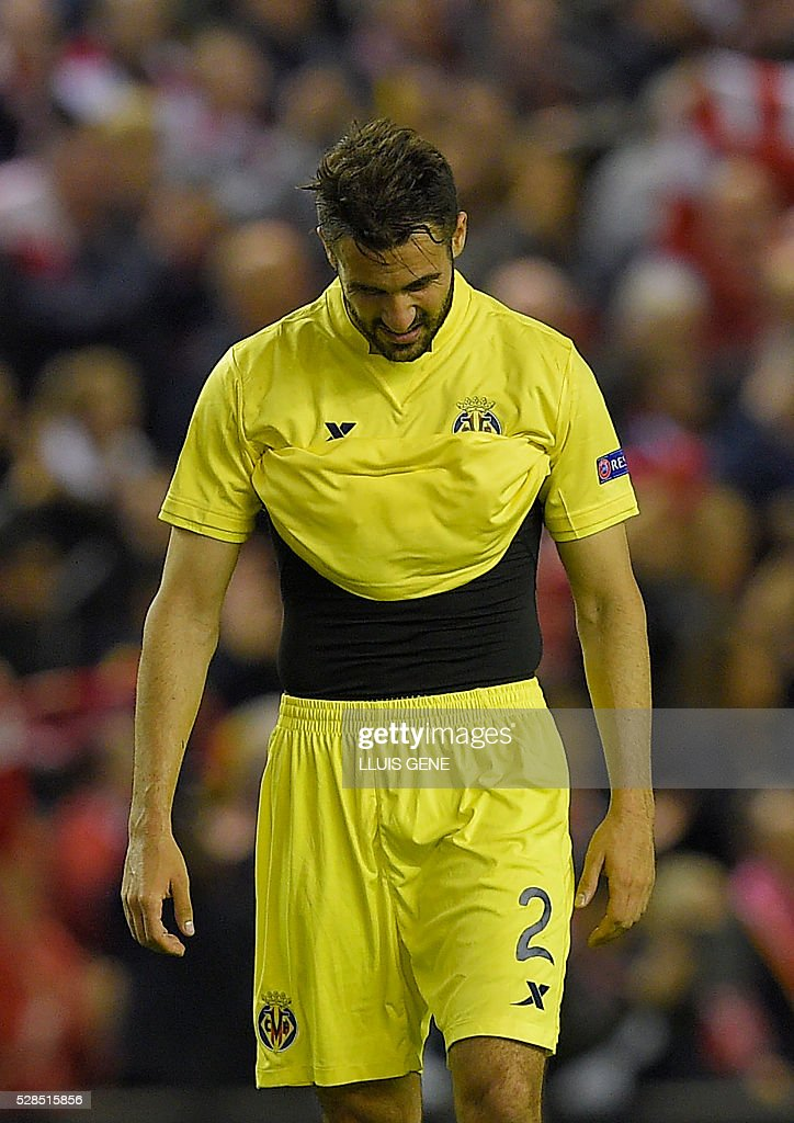 Villarreal's defender Mario gestures at the final whistle after a 0-3 defeat during the UEFA Europa League semi-final second leg football match between Liverpool and Villarreal CF at Anfield in Liverpool, northwest England on May 5, 2016. / AFP / LLUIS