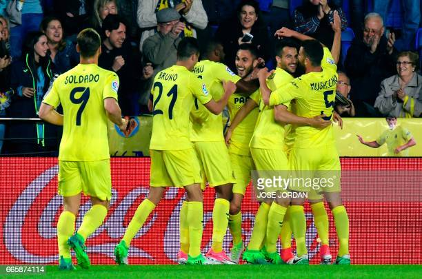 Villarreal's defender Victor Ruiz celebrates a goal with teammates during the Spanish league football match Villarreal CF vs Athletic Club Bilbao at...