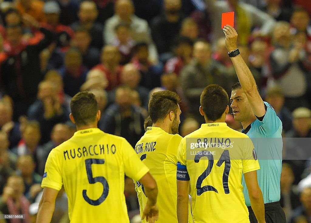 Villarreal's defender Victor Ruiz (3rd R) is shown the red card during the UEFA Europa League semi-final second leg football match between Liverpool and Villarreal CF at Anfield in Liverpool, northwest England on May 5, 2016. / AFP / LLUIS