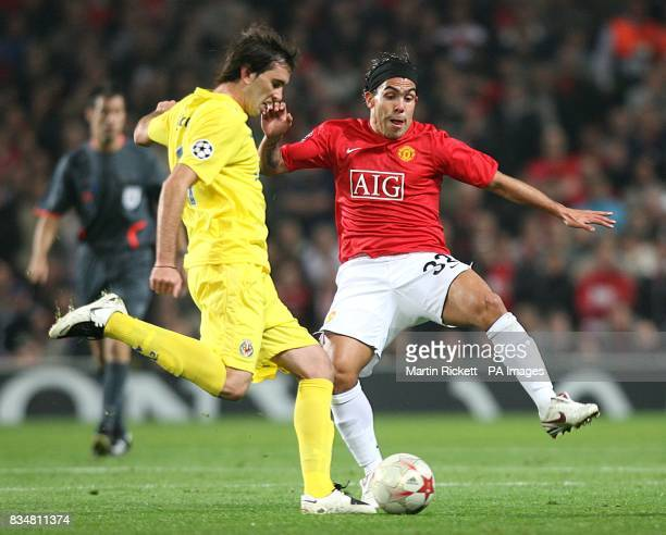 Villarreal's Diego Godin and Manchester United's Carlos Tevez in action