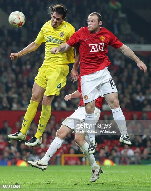 Villarreal's Diego Godin and Manchester United's Wayne Rooney battle for the ball