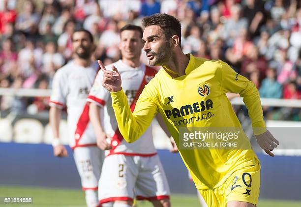 Villarreal's forward Adrian celebrares after scoring during the Spanish league football match CF Rayo Vallecano vs Villarreal CF at the Vallecas...