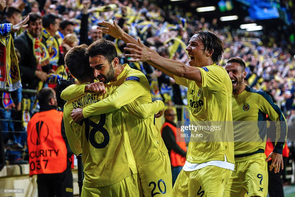 Villarreal's forward Adrian Lopez (2nd R) celebrates a goal with teammates midfielder Denis Suarez (L) and midfielder Tomas Pina (R) during the UEFA Europa League semifinal first leg football match Villarreal CF vs Liverpool FC at El Madrigal stadium in Vila-real on April 28, 2016. / AFP / BIEL