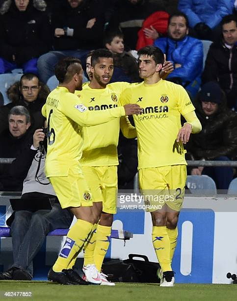 Villarreal's forward Gerard Moreno Villarreal's Mexican forward Giovani Dos Santos and Villarreal's Mexican midfielder Jonathan Dos Santos Ramirez...