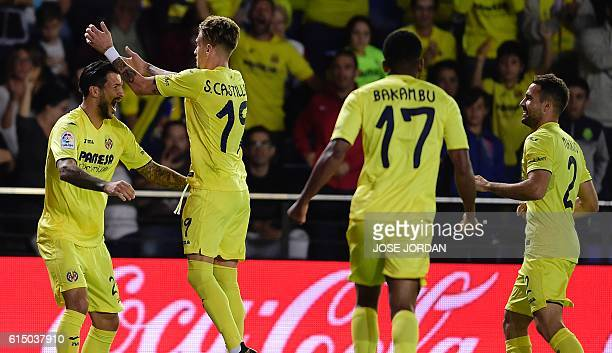 Villarreal's German midfielder Roberto Soriano celebrates after scoring with teammates during the Spanish league football match Villarreal CF vs RC...