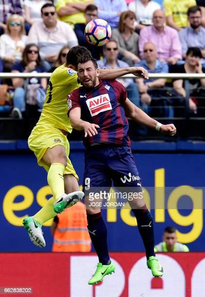 Villarreal's Italian defender Daniele Bonera vies with Eibar's forward Sergi Enrich during the Spanish league football match Villarreal CF vs SD...