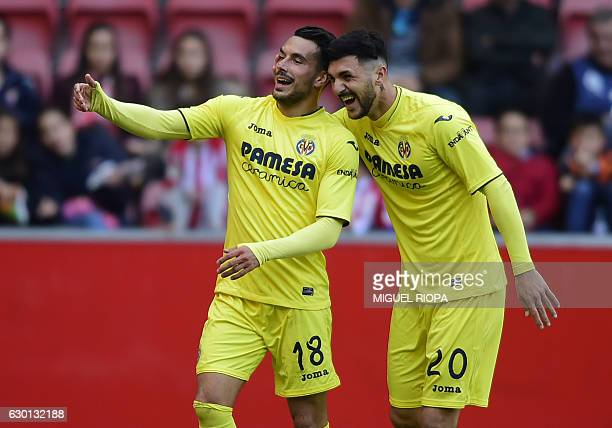 Villarreal's Italian forward Nicola Sansone celebrates with teammate Italian forward Roberto Soriano after scoring a goal during the Spanish league...