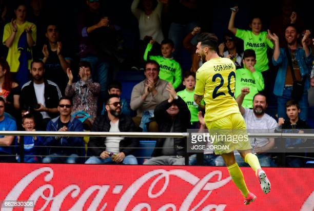 Villarreal's Italian midfielder Roberto Soriano celebrates a goal during the Spanish league football match Villarreal CF vs SD Eibar at Estadio de la...