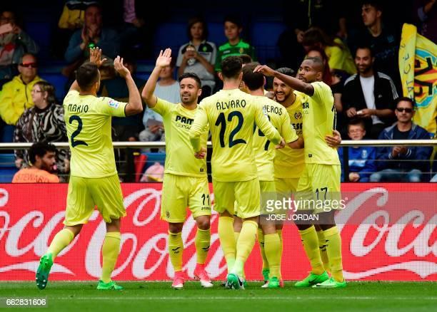 Villarreal's Italian midfielder Roberto Soriano celebrates a goal with teammates during the Spanish league football match Villarreal CF vs SD Eibar...