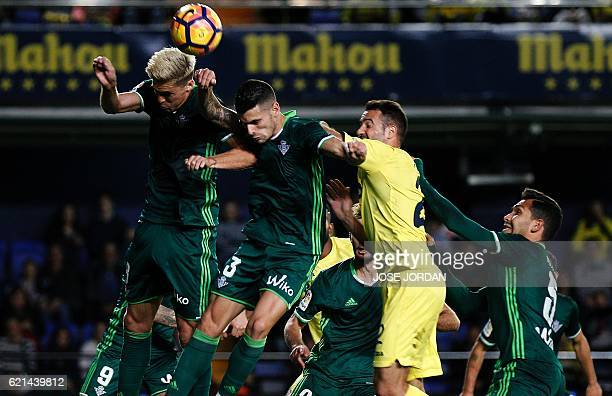 Villarreal's Italian midfielder Roberto Soriano vies with Betis' French midfielder Jonas Martin Betis' Algeria defender Mandi and Betis' Brazilian...