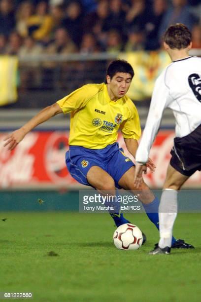 Villarreal's Juan Riquelme and Torpedo Moscow's Aleksandr Lukhvich battle for the ball