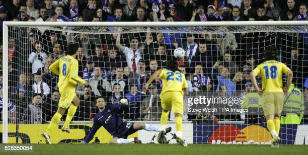 Villarreal's Juan Riquelme scores from a penalty kick during the UEFA Champions League match against Rangers at Ibrox Stadium Glasgow Wednesday...