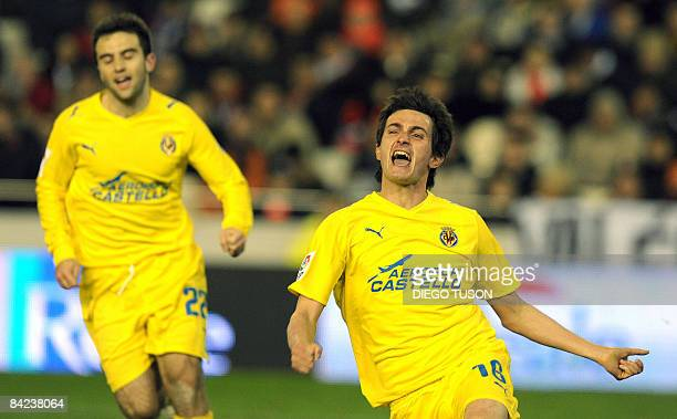 Villarreal's Llorente celebrates against Valencia his goal during their Spanish league football match at Mestalla Stadium in Valencia on January 10...