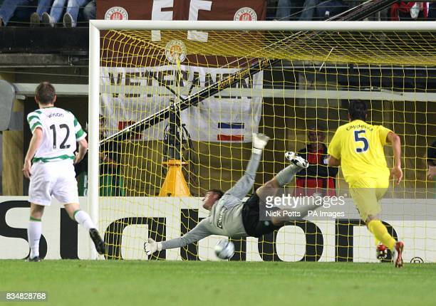 Villarreal's Marcos Senna scores the first goal of the game as Celtic's goalkeeper Artur Boruc fails to stop his freekick