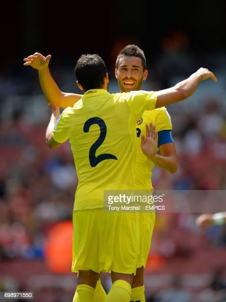 Villarreal's Mario Gaspar celebrates scoring their first goal with Bruno Soriano