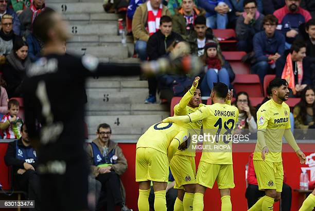 Villarreal's Mexican forward Jonathan dos Santos celebrates with teammates after scoring the opening goal during the Spanish league football match...