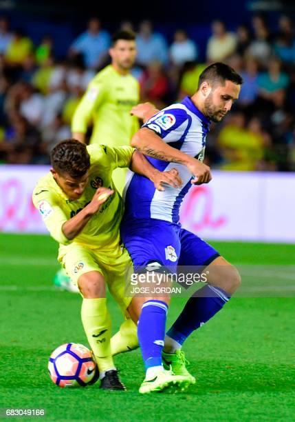 Villarreal's Mexican midfielder Jonathan dos Santos vies with Deportivo La Coruna's Romanian forward Florin Andone during the Spanish league football...