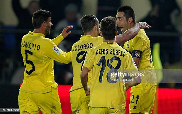 Villarreal's midfielder Bruno Soriano celebrates with teammates after scoring during the Spanish league football match Villarreal CF vs Granada FC at...