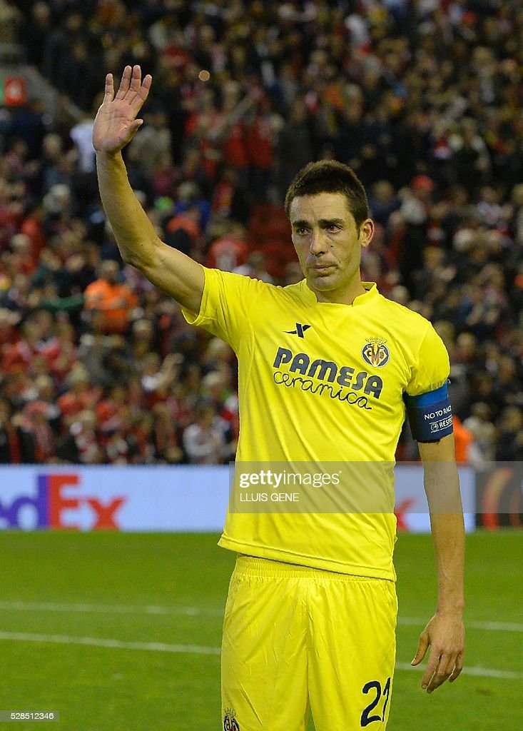 Villarreal's midfielder Bruno Soriano gestures at the final whistle after a 0-3 defeat during the UEFA Europa League semi-final second leg football match between Liverpool and Villarreal CF at Anfield in Liverpool, northwest England on May 5, 2016. / AFP / LLUIS