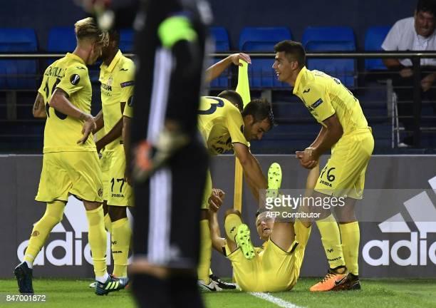 Villarreal's midfielder from Russia Denis Cheryshev celebrates a goal during the Europa League football match Villarreal CF vs FC Astana at La...