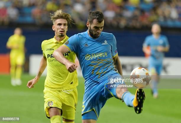 Villarreal's midfielder from Spain Samuel Castillejo Azuaga vies Astana's defender from BosniaHerzegovina Marin Anicic during the Europa League...