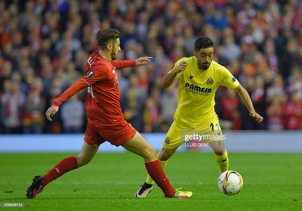 Villarreal's midfielder Jaume Costa (R) is challenged by Liverpool's English midfielder Adam Lallana during the UEFA Europa League semi-final second leg football match between Liverpool and Villarreal CF at Anfield in Liverpool, northwest England on May 5, 2016. / AFP / LLUIS