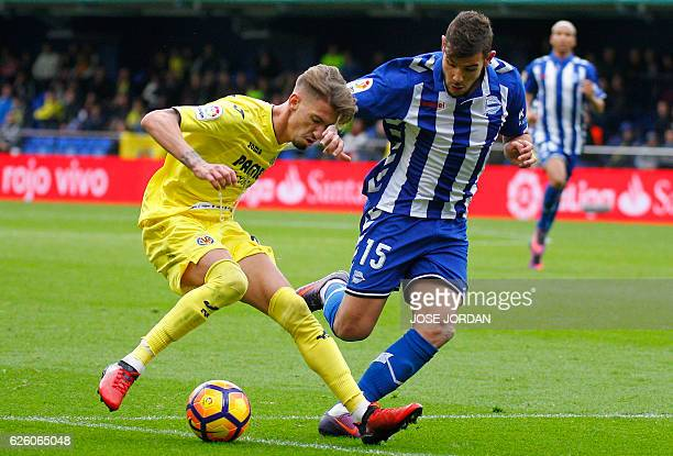 Villarreal's midfielder Samuel Castillejo vies with Deportivo Alaves' French defender Theo Hernandez during the Spanish league football match...