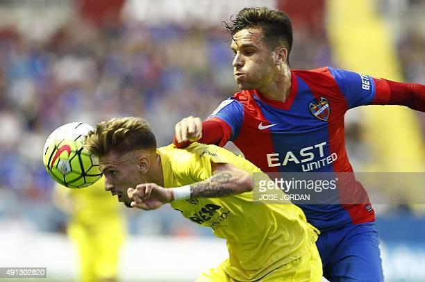 Villarreal's midfielder Samuel Castillejo vies with Levante's defender Tono during the Spanish league football match Levante UD vs Villarreal CF at...