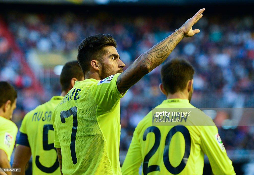 Villarreal's midfielder Samuel Garcia (L) celebrates after scoring during the Spanish league football match Valencia CF vs Villarreal CF at the Mestalla stadium in Valencia on May 1, 2016. / AFP / JOSE