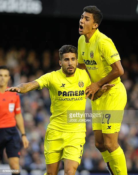 Villarreal's midfielder Samuel Garcia celebrates with Villarreal's forward Adrian Lopez after scoring during the Spanish league football match...
