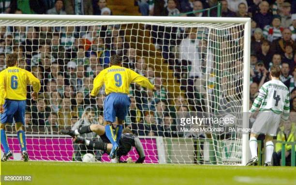 Villarreal's Moreno Verdu Jose Joaquin scores past Celtic keeper David Marshall with Roma Riquelme Juan and Jackie McNamara looking during their UEFA...