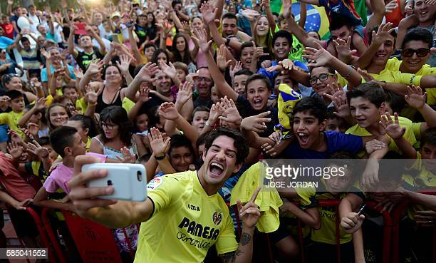 Villarreal's new signing Brazilian Alexandre Rodrigues da Silva 'Pato' takes selfies with fans during his Official presentation at Ermita de la Mare...