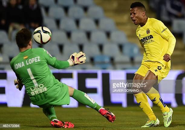 Villarreal's Nigerian forward Ikechukwu Uche vies with Getafe's goalkeeper Jonathan Lopez during the Spanish Copa del Rey quarter final second leg...