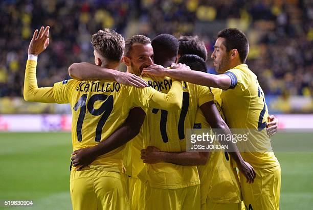 Villarreal's players celebrate a goal during the UEFA Europa League quarter finals first leg football match Villarreal CF vs AC Sparta Praha at El...
