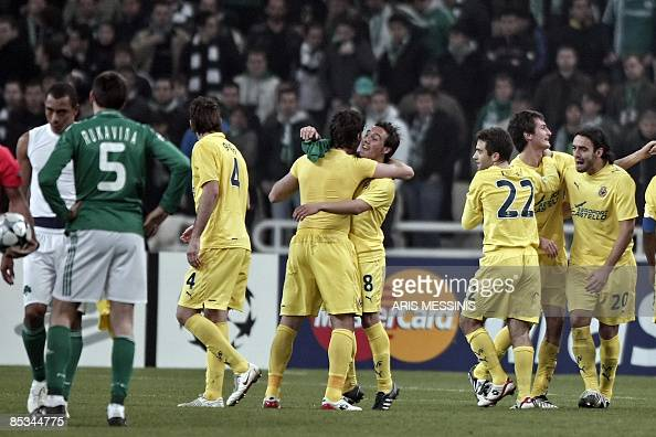 Villarreal's players celebrate after beating Panathinaikos during their UEFA Champions League second round second leg football match at the Olympic...