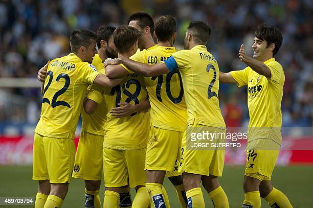 Villarreal's players celebrate an own goal by Malaga's Argentinian midfielder Fernando Damian Tissone during the Spanish league football match Malaga...