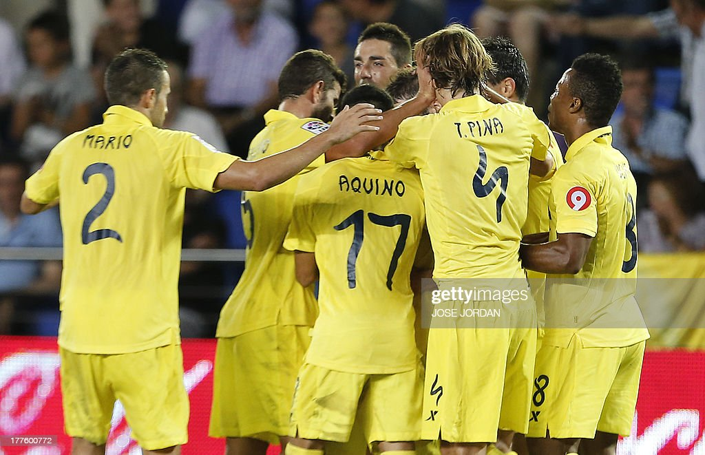 Villarreal's players celebrate their second goal during the Spanish league football match Villarreal CF vs Real Valladolid FC de Madrid at El Madrigal stadium in Villareal on August 24, 2013.