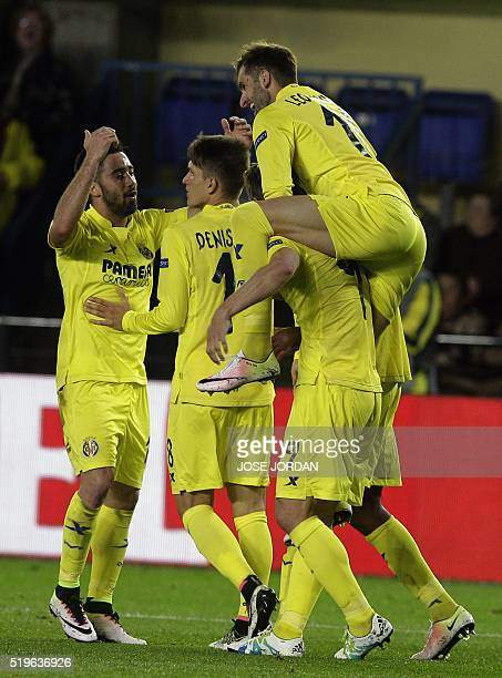 Villarreal's players celebrate their second goal during the UEFA Europa League quarter finals first leg football match Villarreal CF vs AC Sparta...